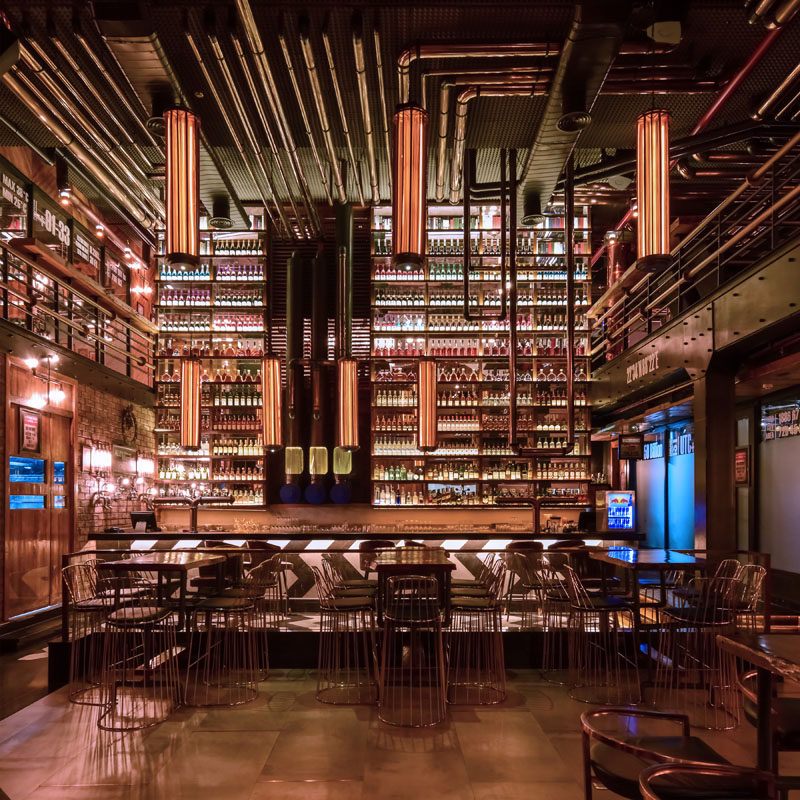 This restaurant has been inspired by a refinery, and to reflect this, the designers used stainless steel pipes finished with PVD coating of copper in glossy, matte and black finishes. #Restaurant #ModernRestaurant
