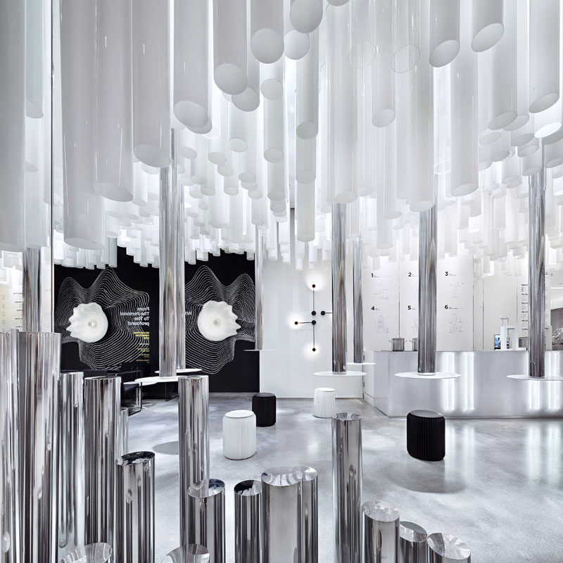 The designer of this tea bar in Guangzhou, China, used three types of tubes made from metal, white acrylic, and transparent acrylic, to creates waves within the interior. #ModernRetailDesign #ModernInterior