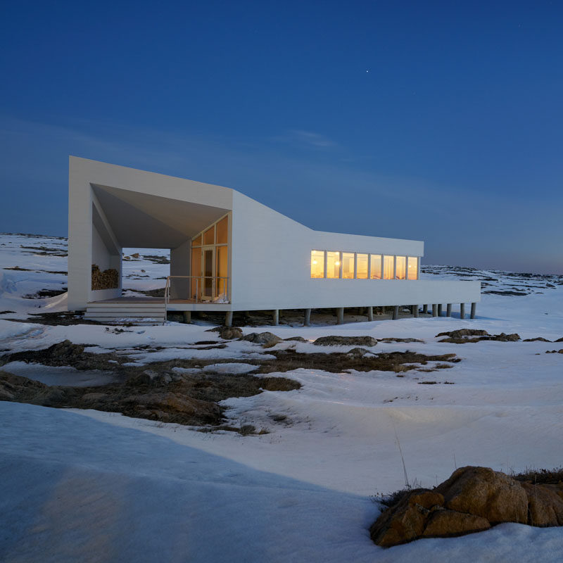This design of this modern dining room for the Fogo Island Shed Hotel, was inspired by the vernacular forms of the region's traditional fishermen's huts and houses. #ModernArchitecture