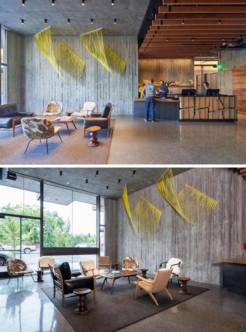 In this modern hotel lobby, flowing three-dimensional sculptures by Sabine Reckewell, help to create a welcoming vibe, while a wall of glass looks out onto the street. #HotelLobby #HotelInterior #HotelDesign #Lobby