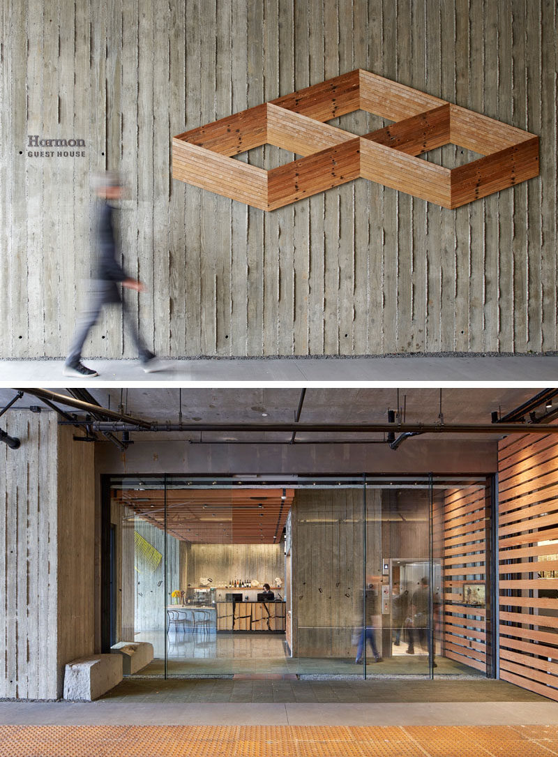 """A textured concrete wall that leads to the lobby of this modern hotel, features an wood art piece by Andy Vogt, which he made from salvaged hardwood lath boards arranged to create two-dimensional Escher-like """"drawings"""" that appear three-dimensional. #HotelDesign #ConcreteWall #WoodWallArt"""