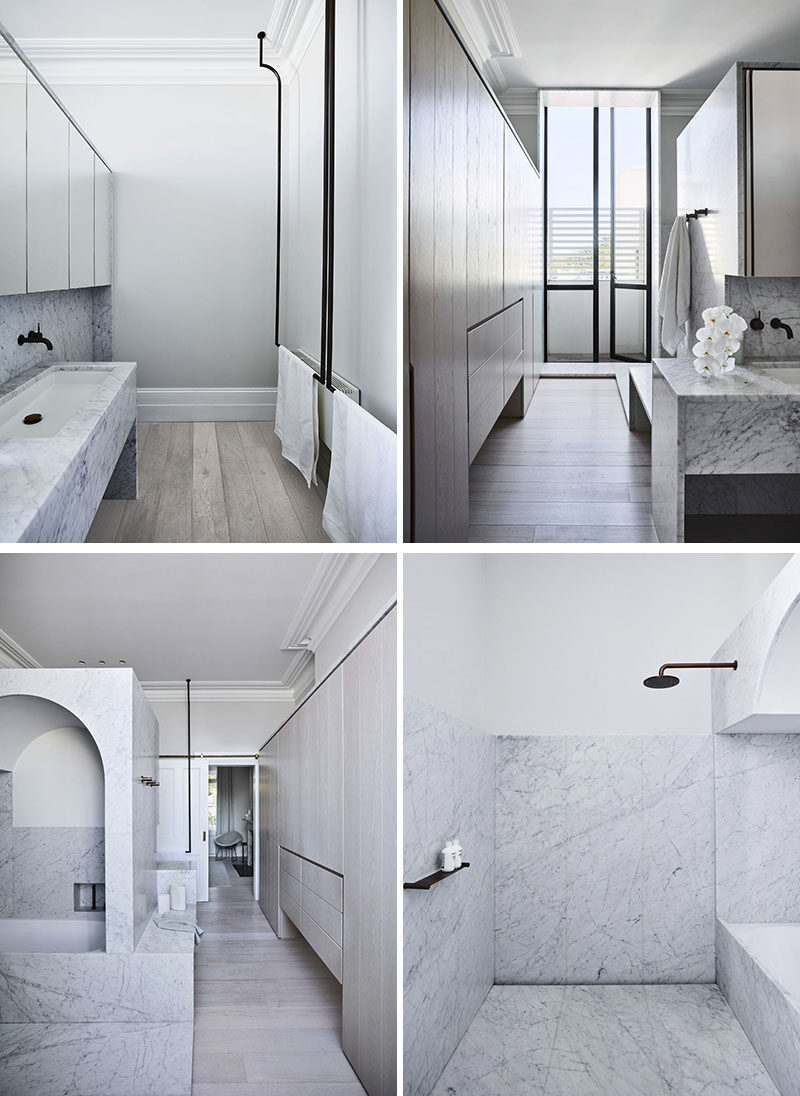 In this modern ensuite bathroom, the shower is tucked away behind a wall that's also home to the vanity on the other side. #EnsuiteBathroom #MasterBathroom #BathroomDesign