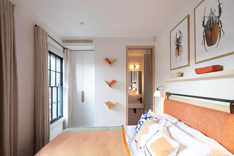 In this modern bedroom, orange has been used to add a colorful touch to the space. #ModernBedroom #BedroomDesign