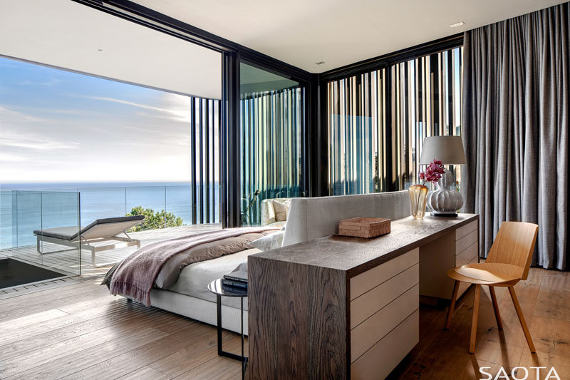 The modern master bedroom is hidden within the slatted box, providing privacy and delicately filtering light into the room. #ModernMasterBedroom #BedroomDesign