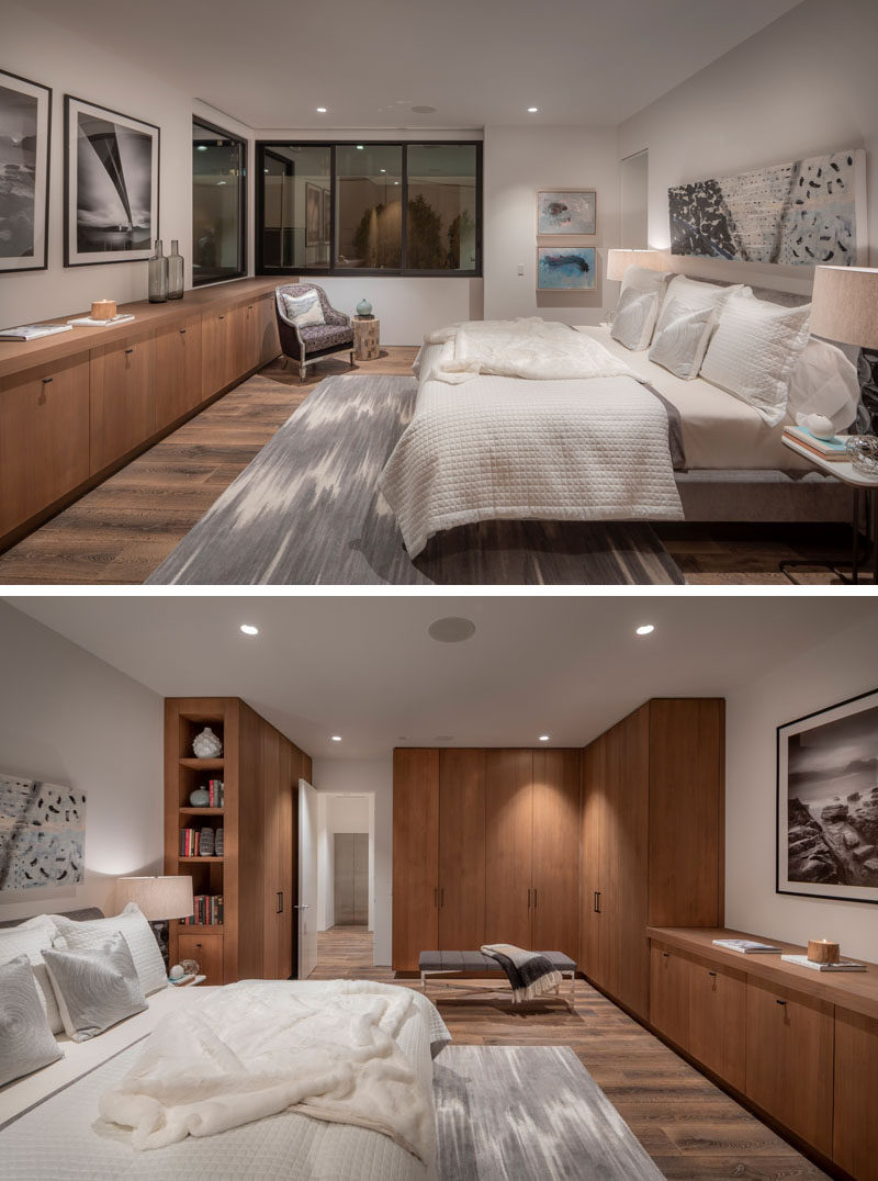 Sinker Cypress (a type of wood that's harvested from logs thatlay on river bottoms for hundreds of years) has been used to create cabinets in this modern master bedroom. #WoodCabinets #MasterBedroom