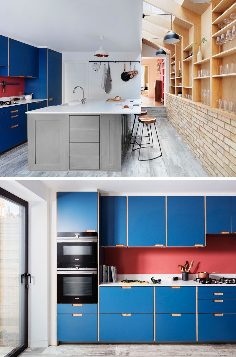 This renovated house features a modified IKEA kitchen finished with blue plywood fronts, and a bespoke kitchen island design with room for seating. A new guest bathroom was added behind the kitchen. #BlueKitchen #KitchenDesign #ModernKitchen