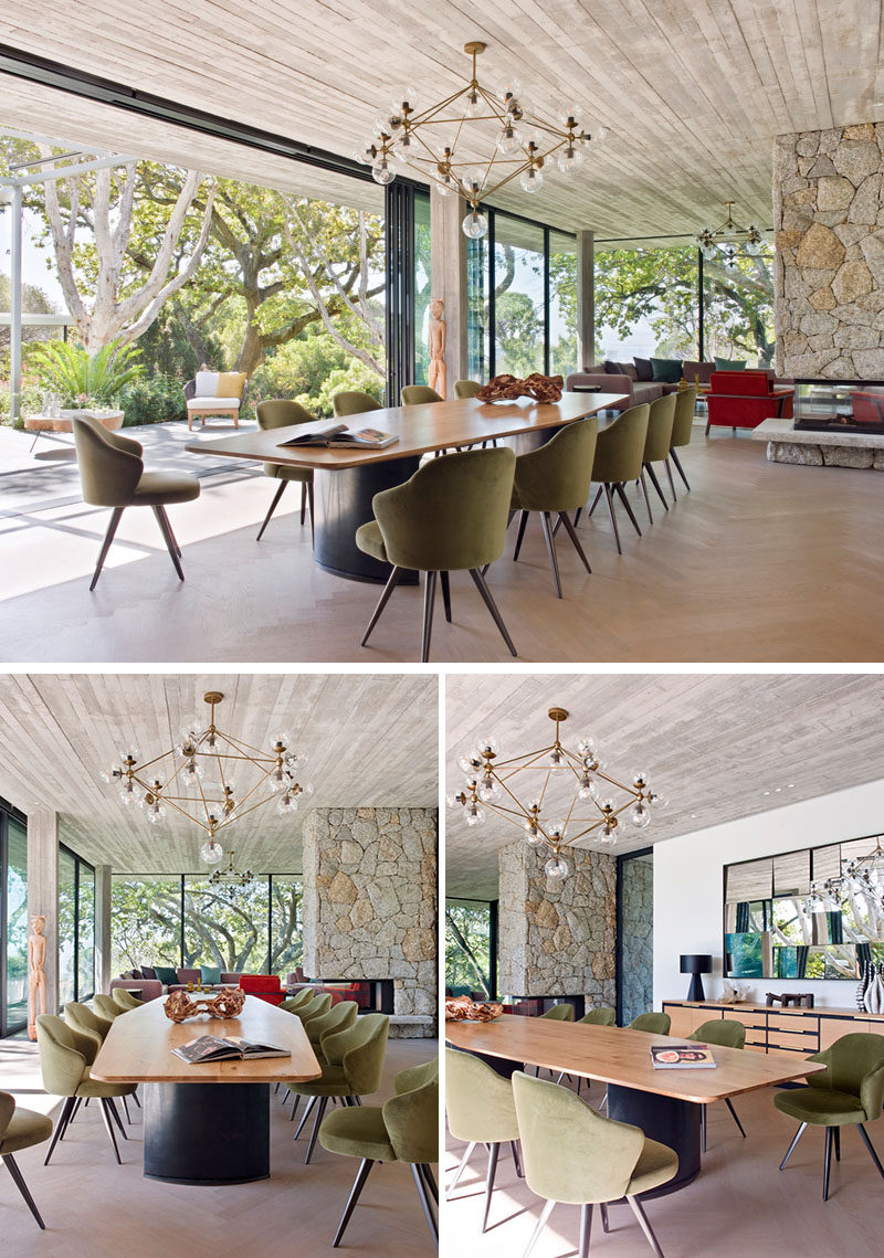 In this modern and open plan dining area, a custom OKHA dining table is surrounded by Minotti dining chairs and a sculptural pendant light. #ModernDiningRoom #OpenPlanDining