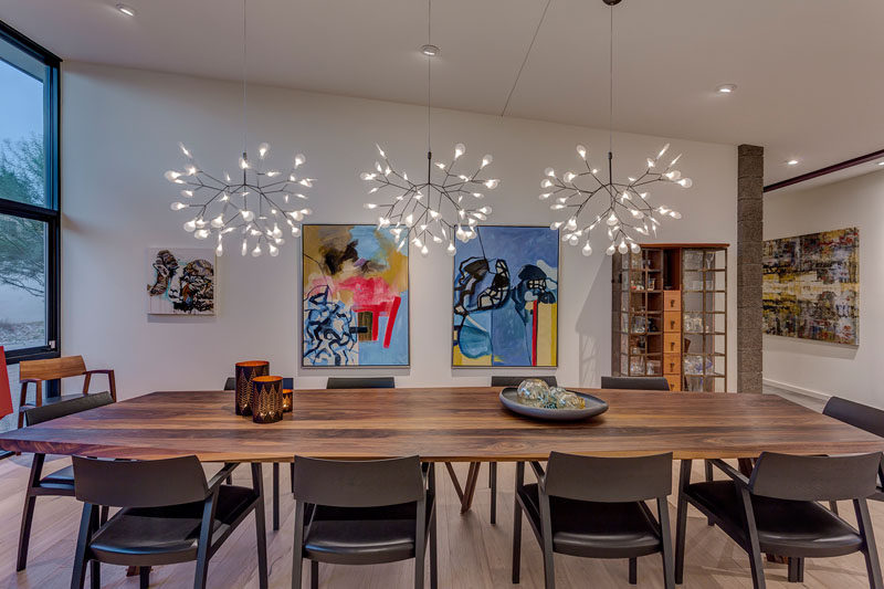 A custom Danish dining room table and elegant light fixtures help define this modern formal dining room. #DiningRoom #ModernDiningRoom