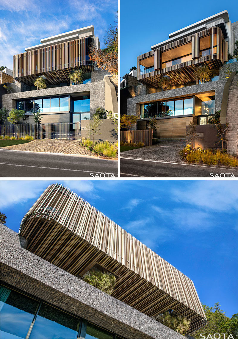 The facade of this modern house showcases a gabion-walled exterior and a vertically slatted box that hovers over a terrace. #Gabion #ModernArchitecture #ModernHouse
