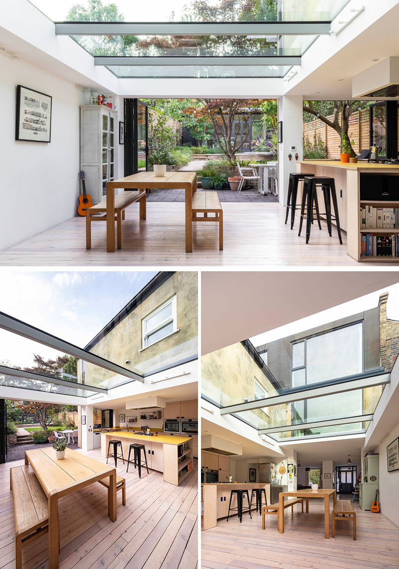 This modern house extension has folding glass doors and a wide slot window in the kitchen, further extending the internal spaces into the garden. #ModernHouseExtension #Skylights #OpenPlanInterior #DiningRoom