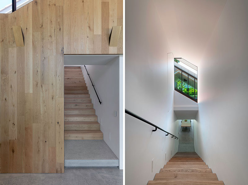 Wood stairs connect the two floors of this modern house, while a window helps to add natural light to the staircase. #Stairs #WoodStairs