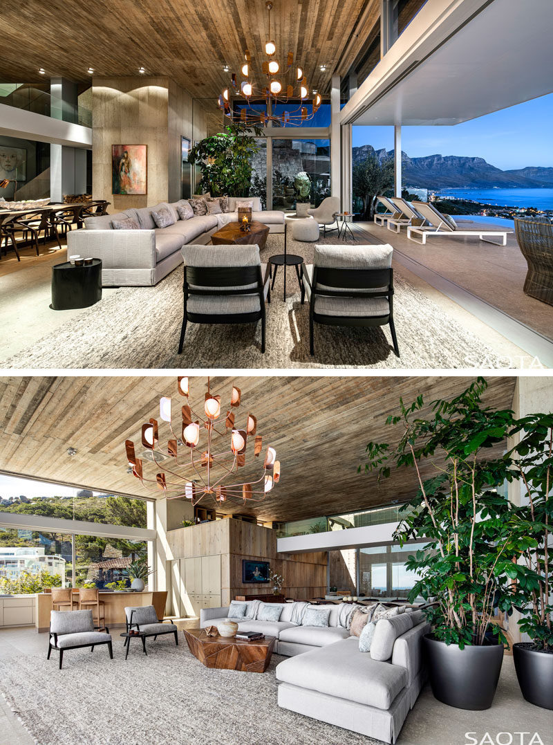 This modern living room has a large couch perfectly positioned to take advantage of the ocean views. #LivingRoom #ModernLivingRoom