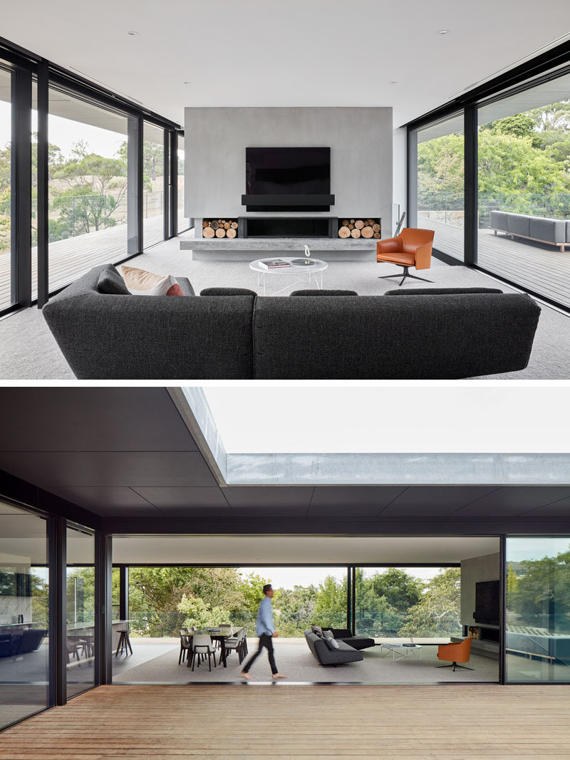 This modern living room is full of natural light from the sliding glass walls on either side of the room. #ModernLivingRoom #GlassWalls