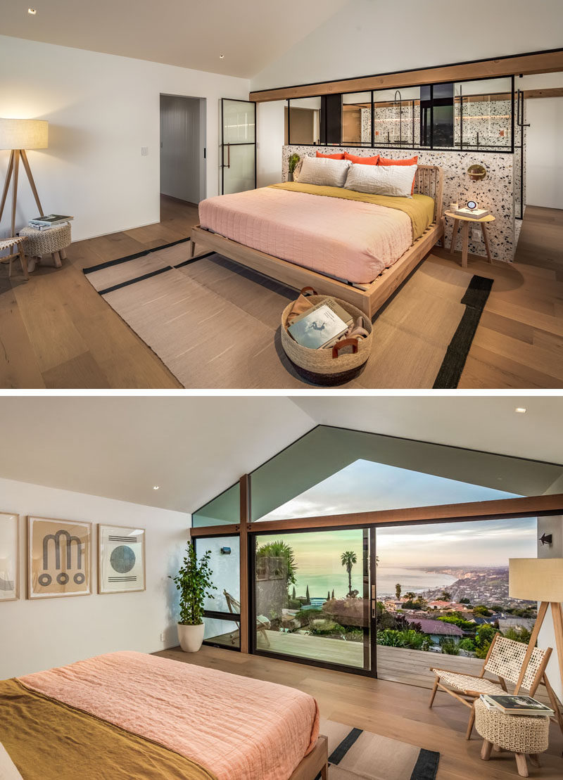 In this modern master bedroom suite, a glass partition showcases the bathroom, and allows views from the balcony to be enjoyed from the bathroom. #ModernBedroom #MasterBedroom