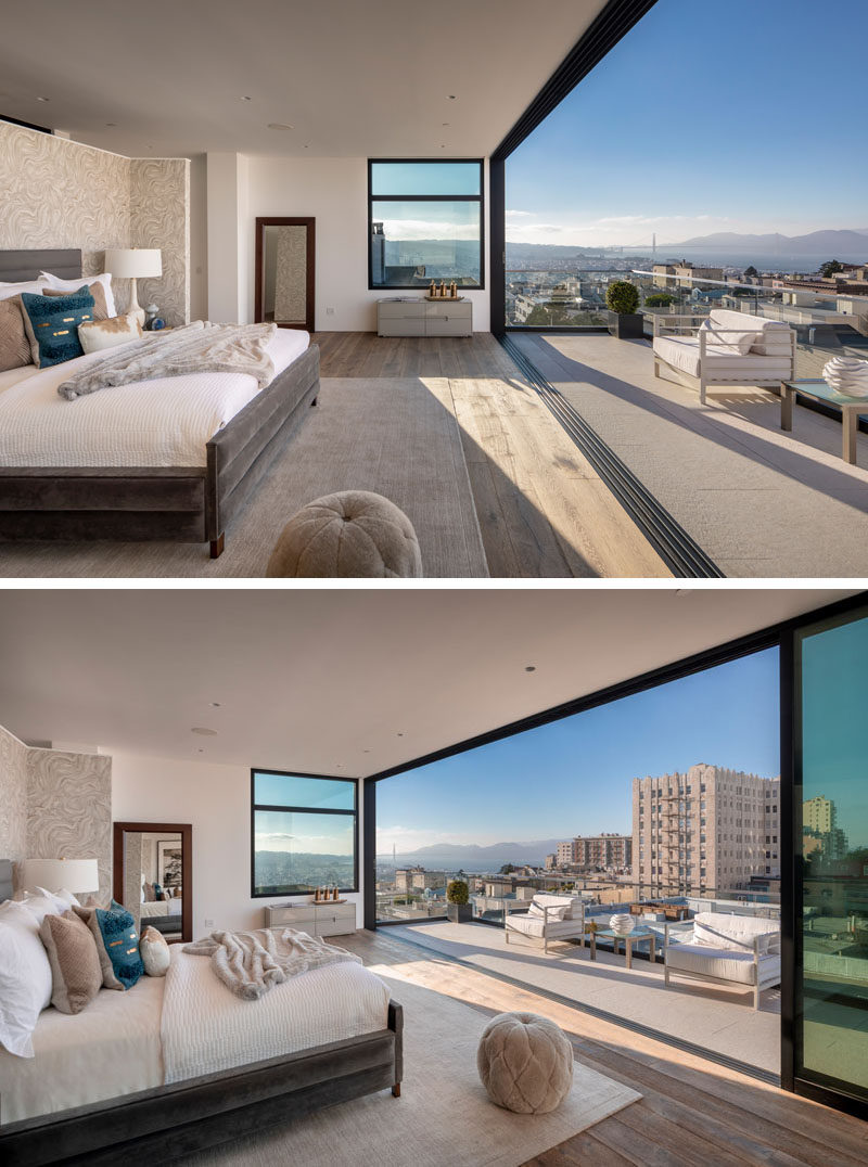 The entire fourth floor of this modern house is dedicated to a master bedroom suite, that has a large sliding glass wall that opens to a private balcony. #MasterBedroom #MasterSuite #ModernBedroom #Balcony