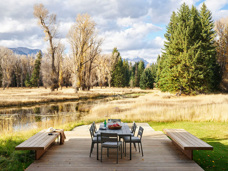 This simple wood deck provides a place for outdoor dining while looking out towards the creek. #Deck #OutdoorDining