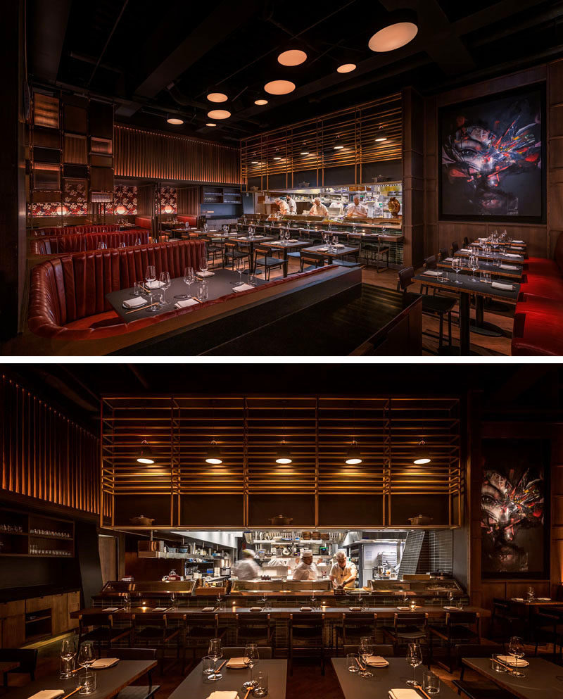 This modern restaurant features an open kitchen that's framed by a chef's table, offering guests privileged views of food preparation. #RestaurantDesign #ModernRestaurant #OpenKitchen