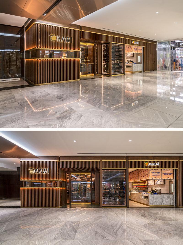 A wood slat facade with hidden lighting helps this modern restaurant stand out. #RestaurantFacade