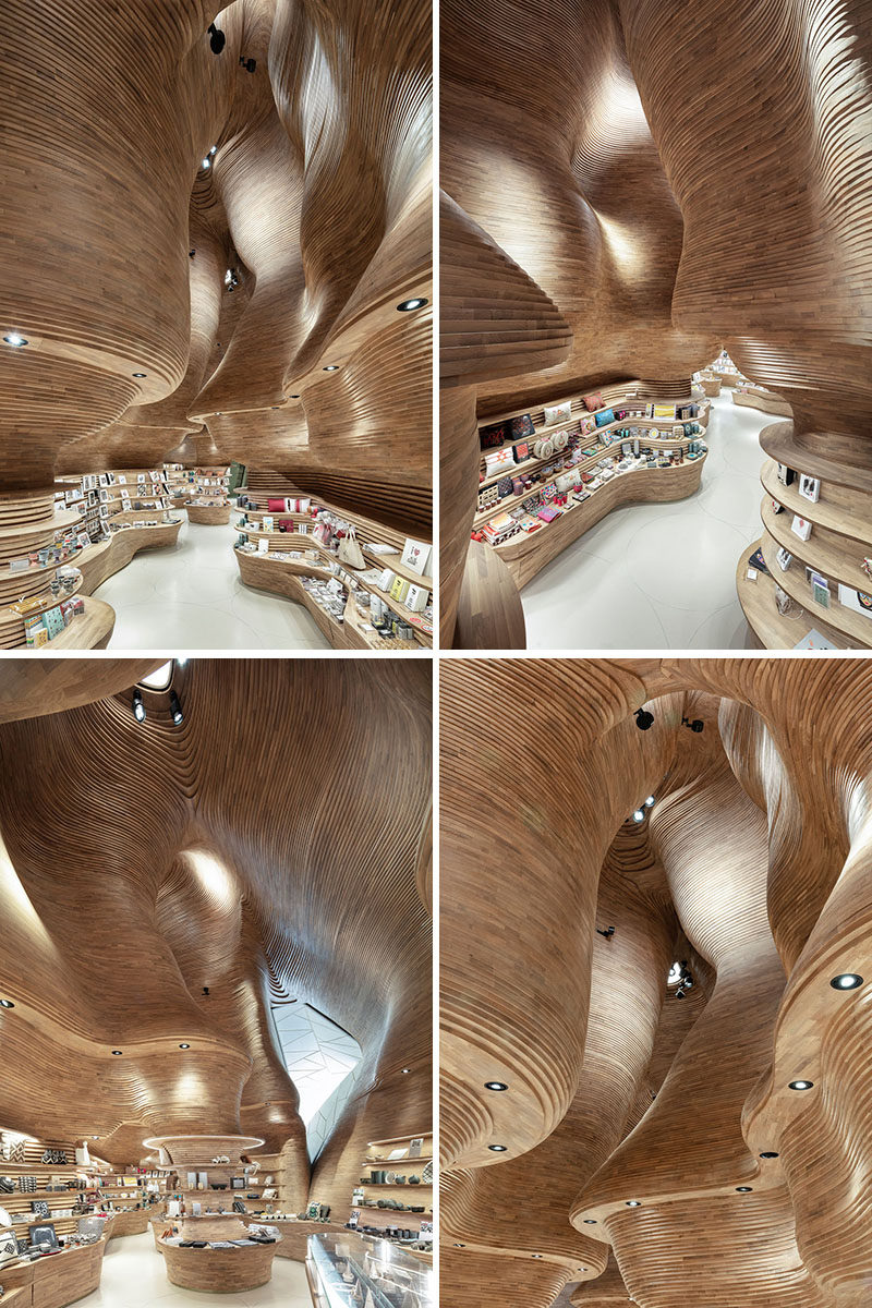 Inspired by a cave, the design of the gift shop at the National Museum of Qatar features 40,000 wood pieces that create a cave-like interior. #RetailDesign #RetailStore #ModernStore #Wood