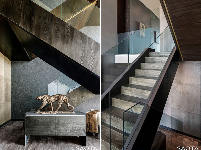 These modern wood stairs have glass handrails that appear to blend into the background. #ModernStairs