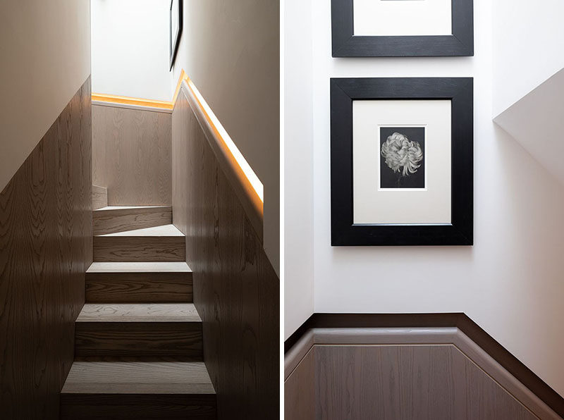 This modern wood staircase has a built-in handrail that features hidden lighting. #Stairs #BuiltInHandrail