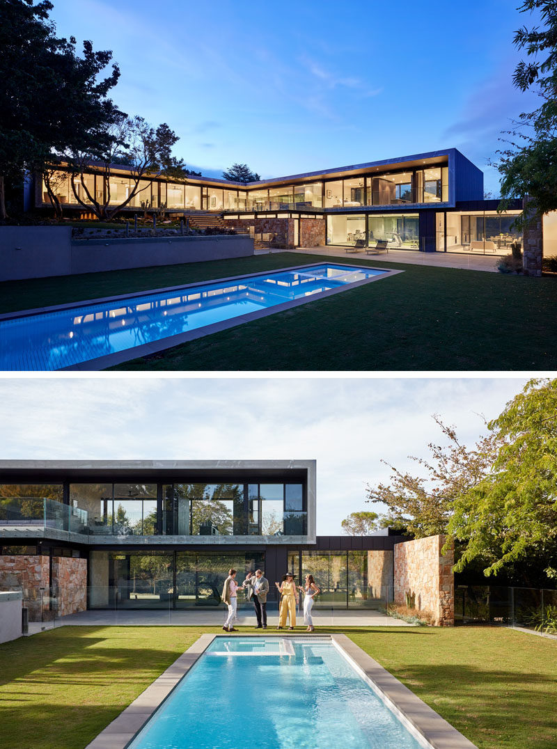 This modern house has a long swimming pool is surrounded by a manicured lawn, providing plenty of space to relax in the sunshine or entertain. #SwimmingPool #ModernArchitecture