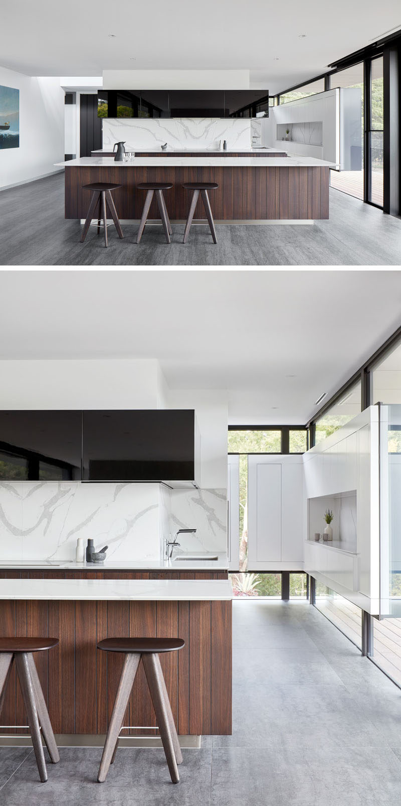 In this modern kitchen, bright white walls are contrasted by black design elements, like cabinetry and window frames, while the wood island adds a touch of warmth to the space. #ModernKitchen #KitchenDesign