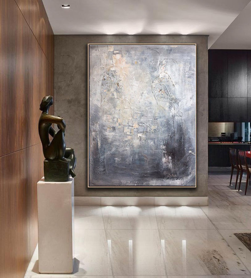 TrendGallery share that this large grey abstract wall art is inspired by the mirrored surface of water, with the dark shapes on the light background recalling the reflections of thunderclouds in pond water. #AbstractWallArt #AbstractArt #LargeArt