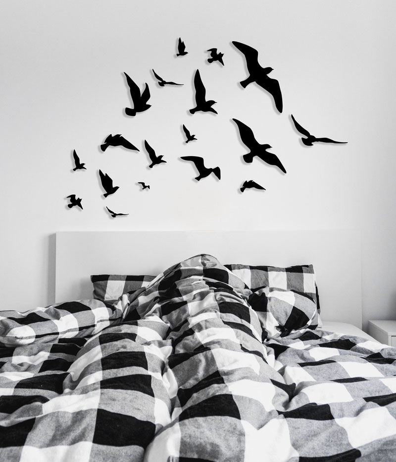 This flying birds wall art has a flock 18 different silhouettes, that are made from painted plywood. #BirdWallArt #BirdArt #BirdHomeDecor #Birds #WoodWallArt