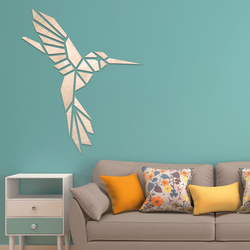 Designed by Magdalena Kok, this modern wall decor in the shape of a Hummingbird, is made from birch plywood. #BirdWallArt #BirdArt #BirdHomeDecor #Birds