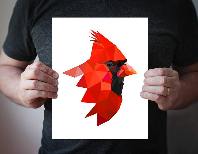 This bright red geometric Cardinal art print was created by villavera. #BirdWallArt #BirdArt #BirdHomeDecor #Birds