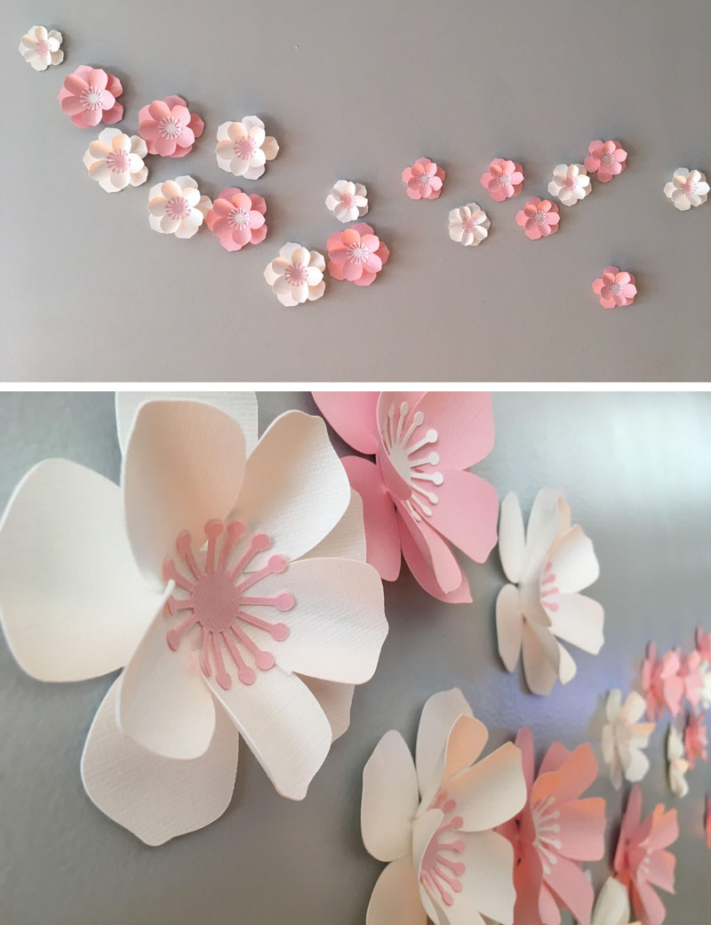 Made by DragonOnTheFly, these delicate cherry blossom flowers are made from paper, allowing them to be placed in different arrangements depending on the room. #CherryBlossomWallArt #CherryBlossom #CherryBlossomDecor #CherryBlossomArt