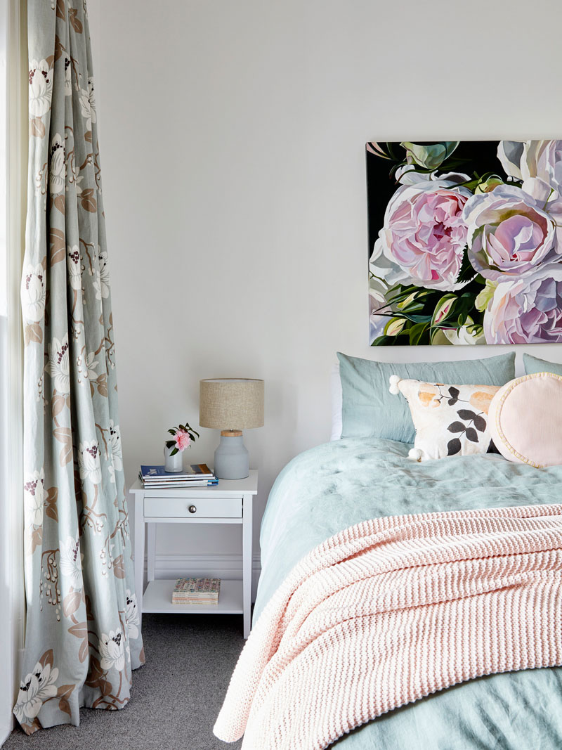 This master bedroom features a soft color palette with pinks and blues. #BedroomIdeas #MasterBedroom