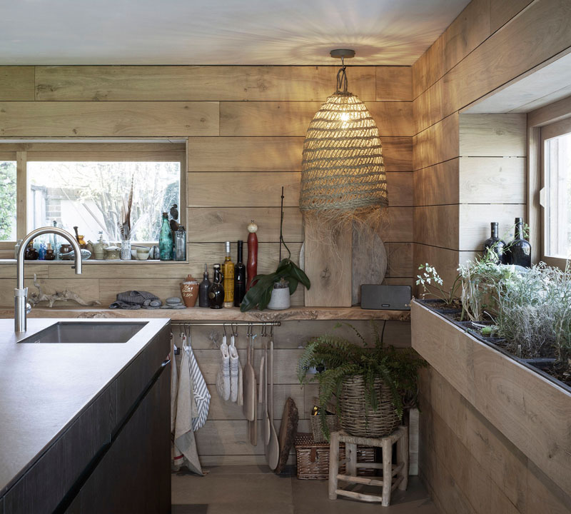 This kitchen is decorated with reclaimed materials, referencing the worn and weary effect of time spent on the beach or at the sea side. #KitchenDesign #ReclaimedMaterials