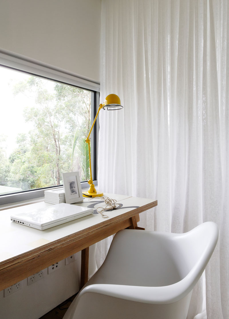 This small office area makes use of the window light to create a bright work environment. #HomeOffice #ModernInterior