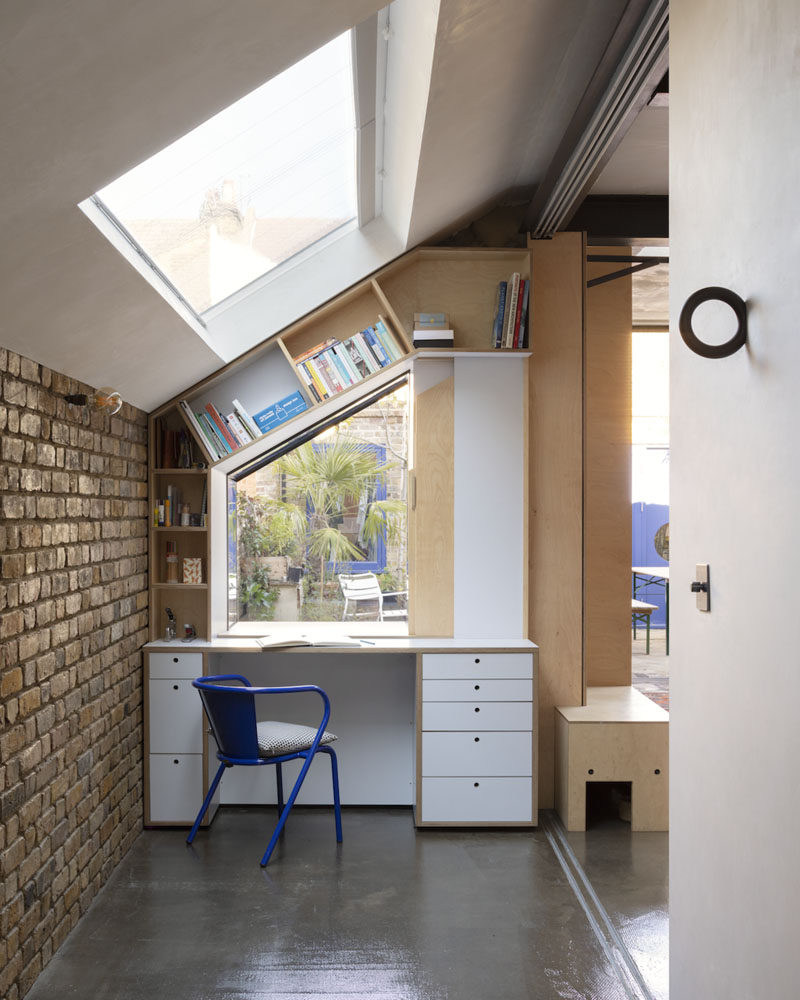 Flexibility of spaces and storage solutions were key elements when designing the interior of this home, and as such, design elements, like this small office nook with angled shelving, have been included. #OfficeNook #Desk #HomeOffice