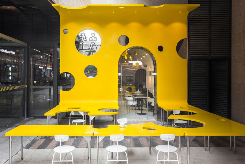 Towodesign has recently completed a new cafe named 'The Dessert KITCHEN', that's located in an underground mall in Chengdu, China, and has an eye-catching facade and an outdoor dining area that's designed like a slice of cheese. #Facade #CafeDesign #RetailDesign