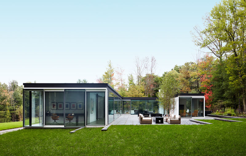 Jamie Drake and Caleb Anderson of Drake/Anderson have designed the interiors of a unique glass house in Columbia County, New York. #GlassHouse #ModernArchitecture