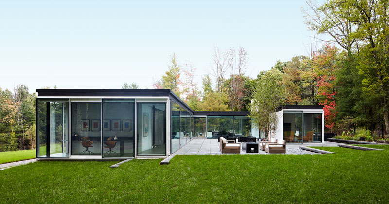 The Exterior Of This Home In New York Is Almost Entirely Made Of Windows