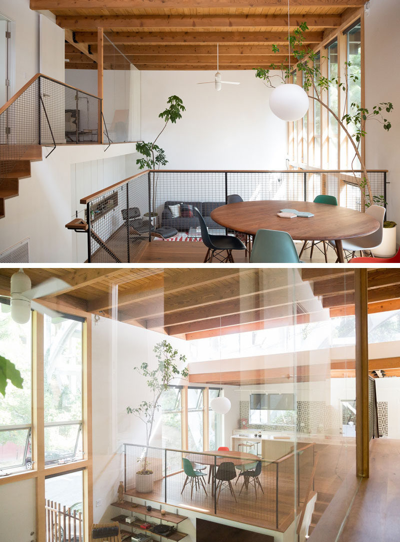The original split level layout of this renovated mid century modern house follows the natural grade of the site, and in the kitchen, a solid wall was replaced with a clerestory window. It frames the bridge in a really interesting way that can be seen from almost every space in the house. #SplitLevel #MidCenturyModern #InteriorDesign