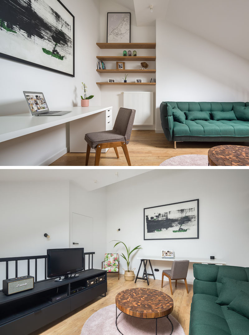 In this modern apartment, a mezzanine is home to a simple black entertainment stand that complements the black balustrade, while open wood shelving makes use of a small alcove. #LivingRoom #Mezzanine #Apartment