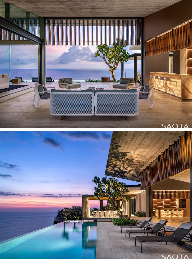 This modern house is located on a limestone cliff edge, and as such, the social areas of the house as well as the swimming pool, all have picturesque ocean views. #ModernInteriorDesign #SwimmingPool #LivingRoom