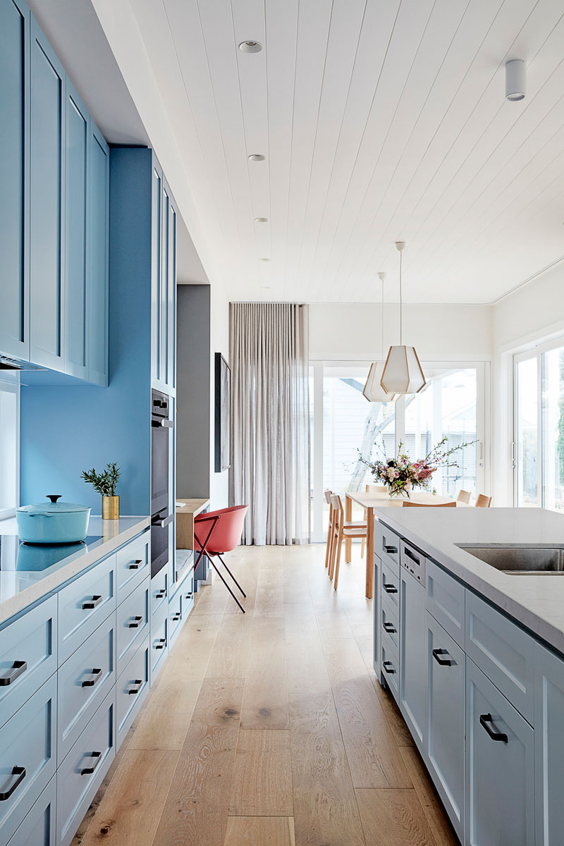 A Wall Of Light Blue Kitchen Cabinets Adds A Colorful Touch