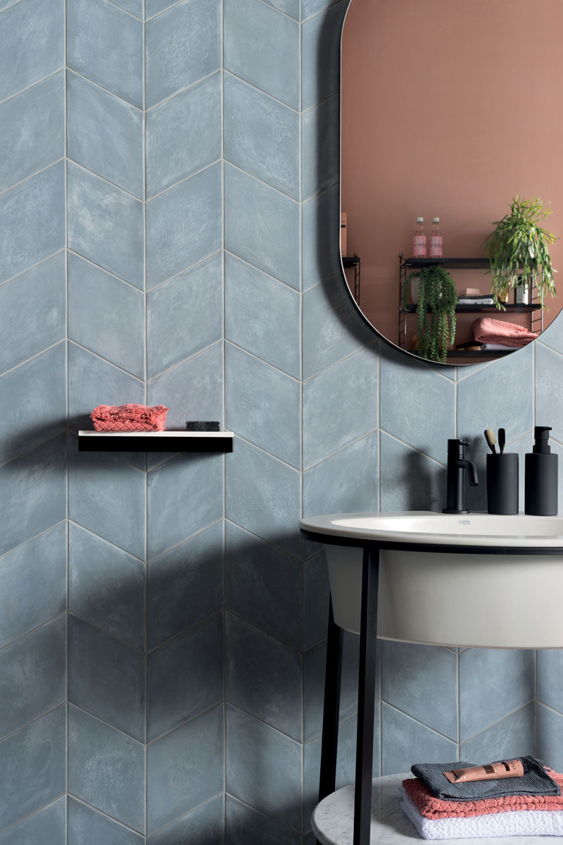 Tiles come in every hue and tone found under the sun, but muted colors have recently taken the tile industry by storm. While vivid colors have their place, the subdued chroma of pale blue allows for designers to apply entire fields of color to a space. #MutedTiles #TileDesign #ModernTiles