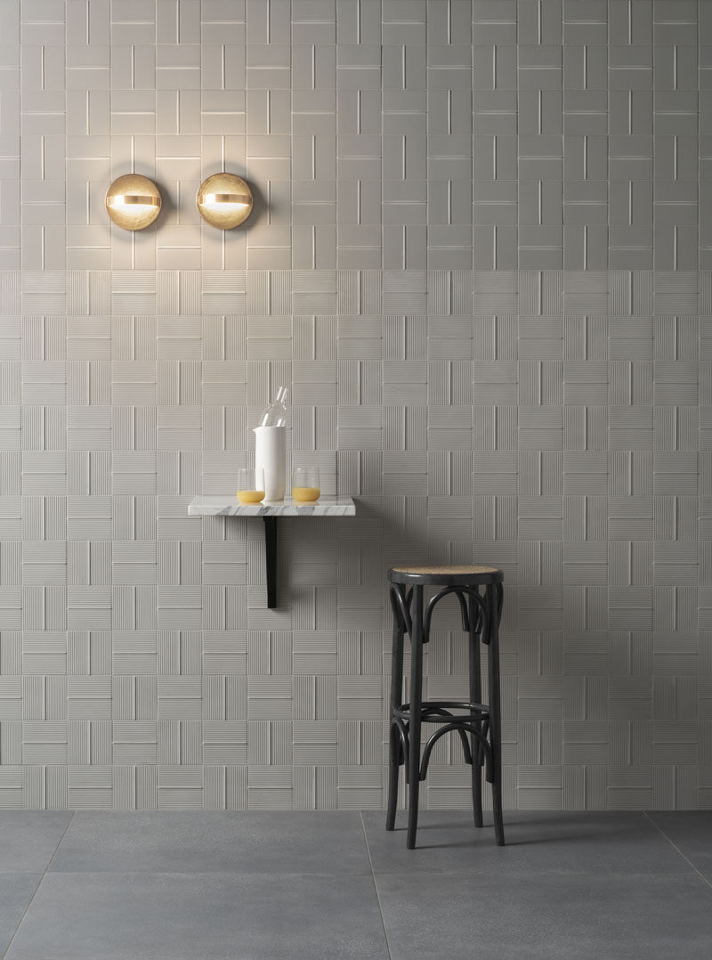 These modern tiles with lines help to create movement, add height, and generate visual interest, in any room. #ModernTiles #TileDesign #ContemporaryTiles