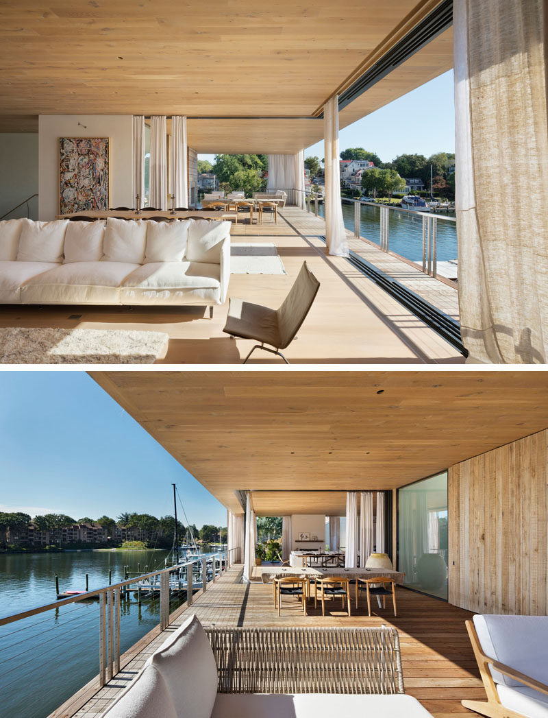The living areas of this modern house are located upstairs, with pocketing sliding glass doors and balconies proving uninterrupted views of the harbor. #ModernHouse #ModernInterior