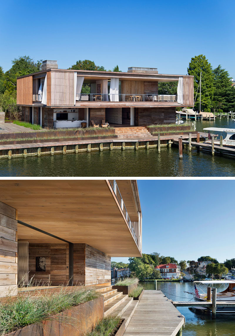 Deep overhangs protect this modern house and provide shade to the decks that surround it. The second floor, also encircled by cantilevered decks and balconies, is wrapped in layers of fixed Ipe screens and operable canvas drapes. #ModernHouse #WaterfrontHouse #ModernArchitecture