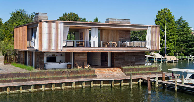 This Waterfront House Has Maximized Its Views Of The Boats Floating In Chesapeake Bay