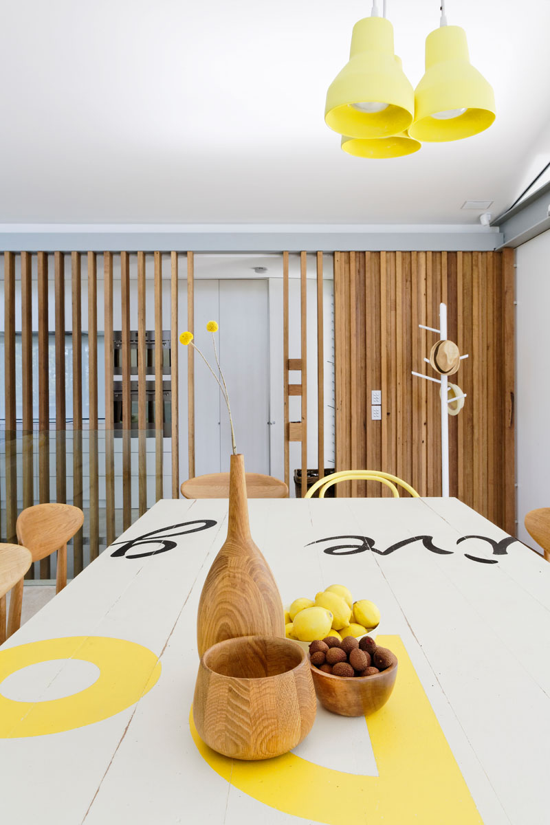 This modern dining area has pops of yellow to keep the interior bright with a sense of fun. #DiningRoom #YellowDecor #InteriorDesign #ModernDiningRoom