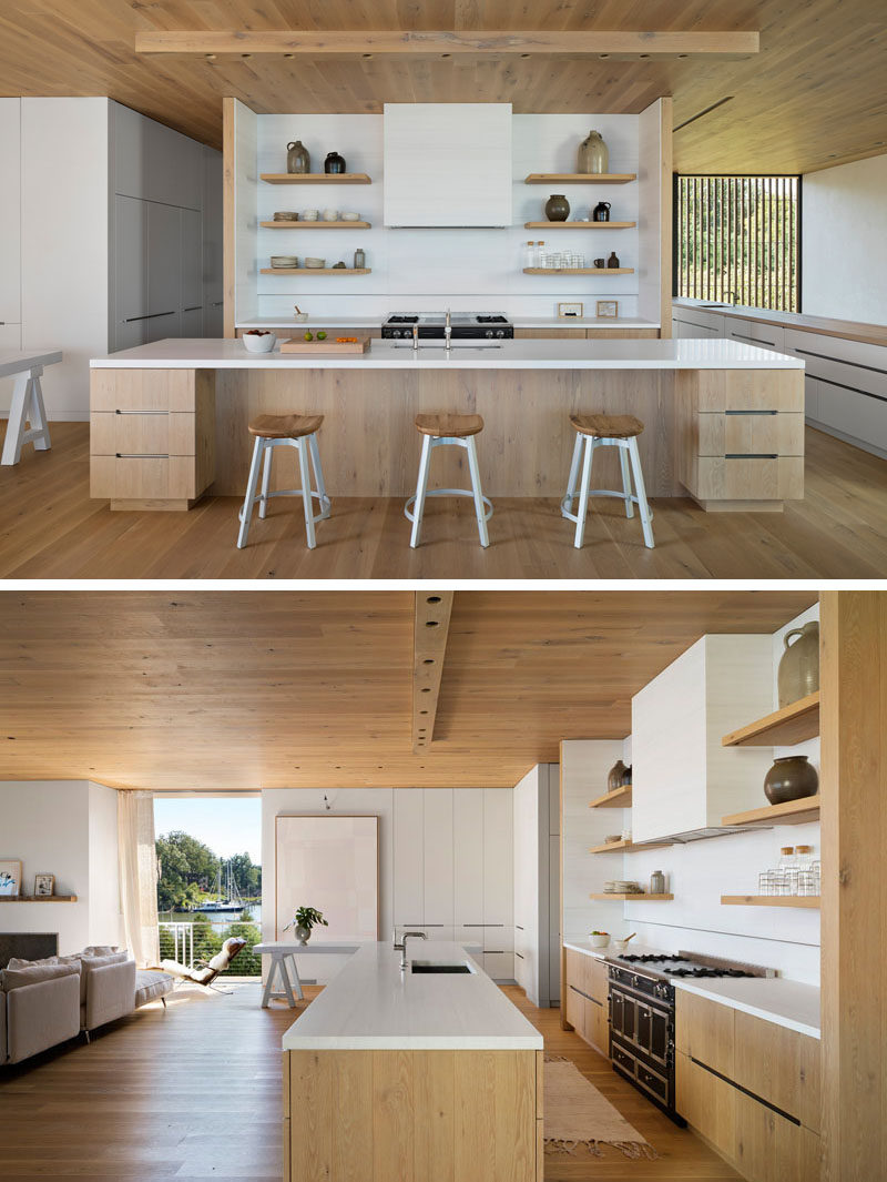 In this modern kitchen, white walls, cabinets, countertops, and furniture complement the surrounding wood, creating a calm and homey appearance. #ModernKitchen #WoodKitchen #WoodAndWhite
